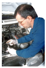 Mechanic Working On Vehicle Engine